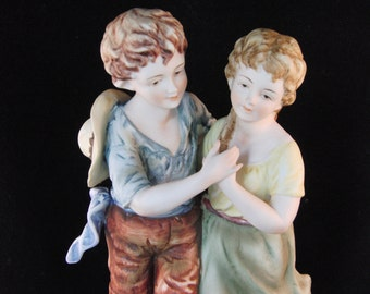 Porcelain figurine of boy and girl by Andrea by Sadek made in Japan