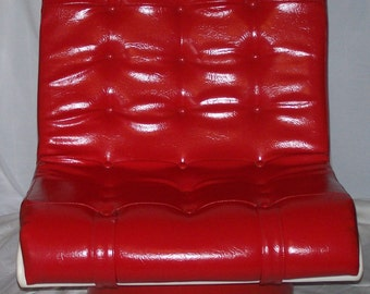 1970s Red vinyl lounge chair with pedestal base.
