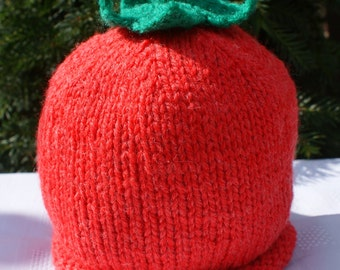 Child's red tomato beanie