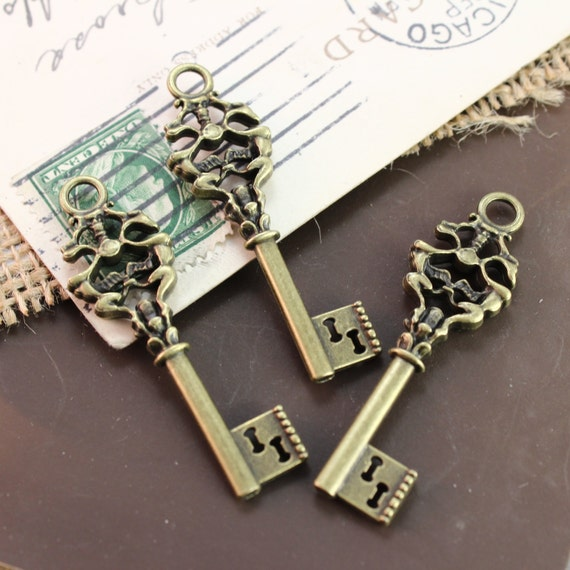 bulk 50 key charms key pendants antique bronze tone skeleton
