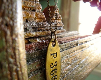 vintage industrial brass tag