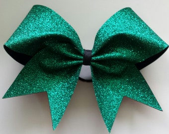 Emerald green cheer bow. Ask about bulk discounts, color and mascot options.