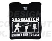 Sasquatch Doesn't Like to Lose Disc Golf Shirt - Black - 50 Cotton / 50 Poly - Copyright K. Loraine