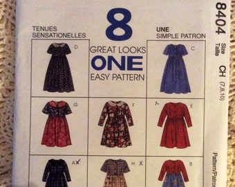 McCall's Child Dress Pattern 8404. Size CH 7, 8, 10. Uncut pattern.  8 Great Look one easy pattern.  1996.