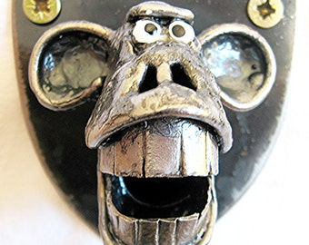 Monkey Bottle Opener , wall mounted and handmade from recycled Steel.