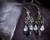 Heartdrop: Glam Chandelier Earrings (Gunmetal Heart Filigree with White/Black Gem Droplets)