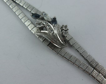 Age old, beautiful, elegant silver bracelet in white gold look (silver Ag 800) with sapphires and cubic zirconia