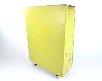 Vintage metal storage cabinet. Yellow Metal Box