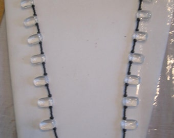 necklace of onyx  beads and white quartz...smart look...