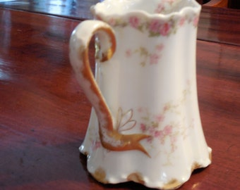 Limoges Pitcher, by Haviland with H&C mark, flower motif, Gold edging, circa 1880's