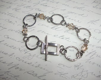 Champagne crystals and hammered rings bracelet