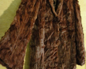 Woman's 1970s fully lined soft curly fur coat 70s
