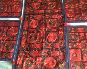 Beautiful hand made table runner with 6 small mats in maroon colour