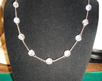 Vintage Silver Tone Faceted Round Crystals.