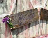Bride-Groom signs (2), purple painted letters, purple silk flowers attached-on barnwood