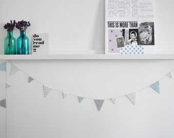 Paper garland of different size printed triangles