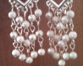 silver chandelier earrings.