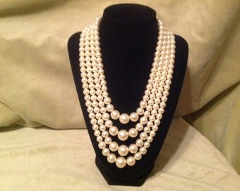 A Vintage Necklace made of  4 strands of Pearls.