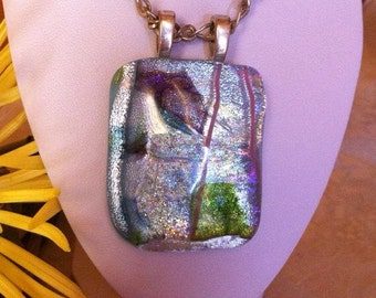 Dichroic glass pendant, with silver chain.