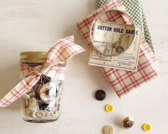 A Half Pint Canning Jar of Buttons