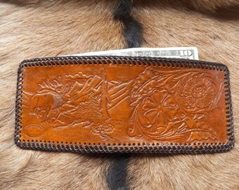 Hand tooled leather wallet, brown stain, has pockets for credit cards and id.