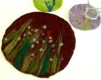 felt placemat with grass and flowers, red