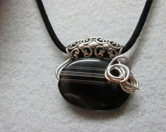 """Onyx and Metal pendant w/18"""" suade cord and 2"""" extention."""