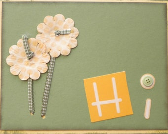 Simple, cute card to say hi. will appeal to both men and women. Uses buttons, ribbons and flowers.