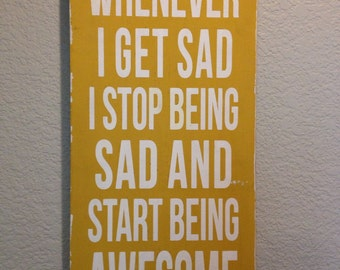 Whenever I get sad I start being AWESOME sign