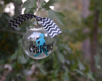 Personalized Customized Girl Basketball Player Clear Glass Ornament decorated with coordinating ribbons