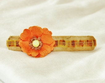 Tan Barrette with an Orange Flower