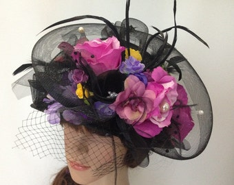 A Black Sinamay Church Hat With Flowers And Mesh