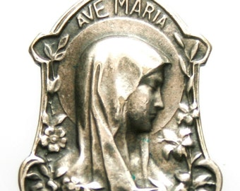 Our lady of Lourdes Vintage Sterling Silver with Saint Bernedtte at the Grotto on the back very rare and beautiful