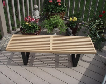 A George Nelson inspired Slat Bench.  Bench is hand crafted inHard Maple