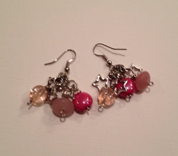 Pink beads and metal star earrings.