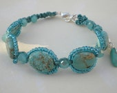 Turquoise and aqua glass, micro macrame bracelet on matching nylon cord. What is a great southwestern accessory?  This is!