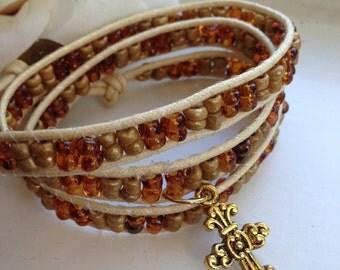 Handmade Celtic Cross Triple Wrap Beaded Bracelet - Amber & Bronze Beads Ivory Cotton Cord and Bronze Clasp Celtic Jewelry Beaded Jewelry
