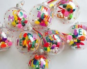 Personalised Christmas bauble- Colourful modern font hand painted with pom poms.