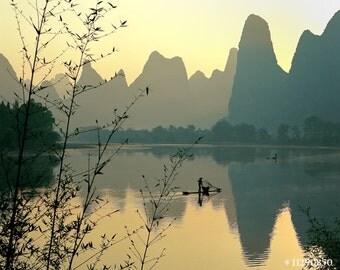 Landscape photography - Chinese fisherman on Li river, Guilin, China