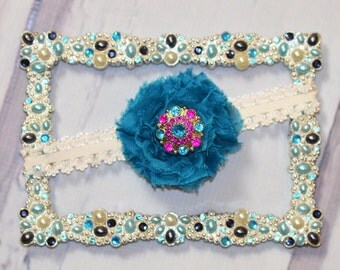 Teal shabby flower with flower gem center on white lace band/clip