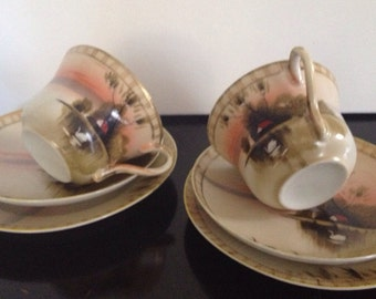 Pair of L & Co Nippon cups and saucers