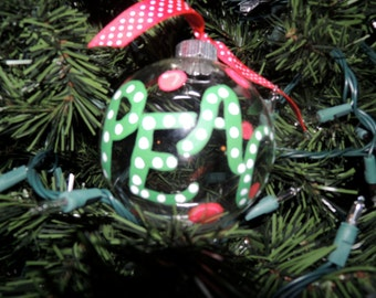 """Hand painted """"peace"""" Christmas ornament"""