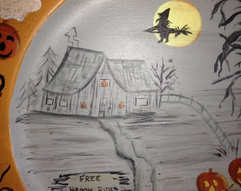 Halloween plate complete with a witch flying by the light of the moon.