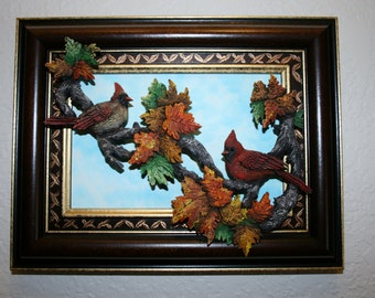 Cardinals handcarved in an Autumn setting. This original Woodcarving  wall hanging  carved from one piece of basswood and painted in oils.