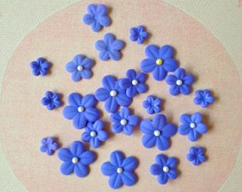36 fondant flowers made by FancyTopCupcake.