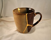 """Deep Beige and Brown 4"""" cup mended with gold seams  - Kintsugi / Kintsukuroi Art"""