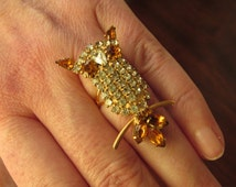 Upcycled Vintage Rhinestone Owl Ring; brushed gold, amber and clear rhinestones; adjustable gold-plated ring band (lead- and nickel-free)