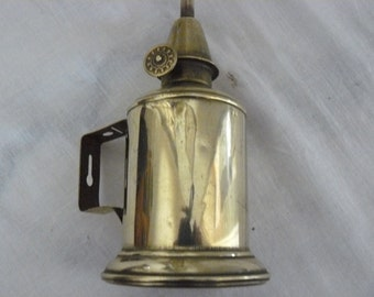 old pigeon brass lamp