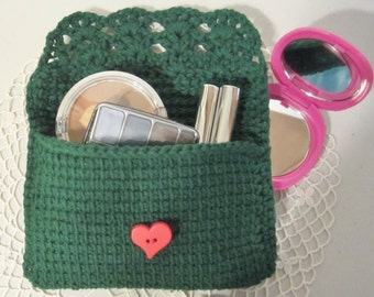 Makeup bag hand crochet with a forest green cotton yarn embellished with a red heartshaped button closure