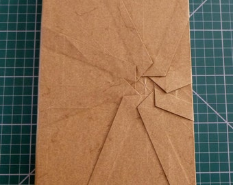 Hand bound (perfect-bound) A5 notebook.